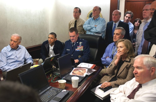 President Barack Obama and Vice President Joe Biden, along with members of the national security team, receive an update on the mission against Osama bin Laden in the Situation Room of the White House on Sunday. (Photo: White House / Pete Souza)