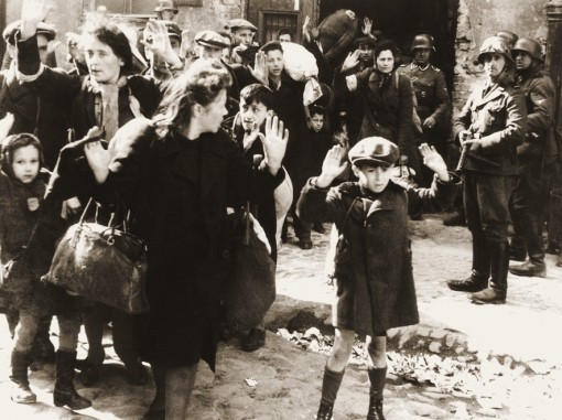Iconic photo of young boy surrendering to German troops during the Warsaw Ghetto uprising. The photo is from Jürgen Stroop Report to Heinrich Himmler from May 1943.